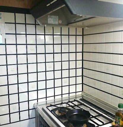 賃貸のキッチンを黒目地のブルックリンタイルにリメイクした後